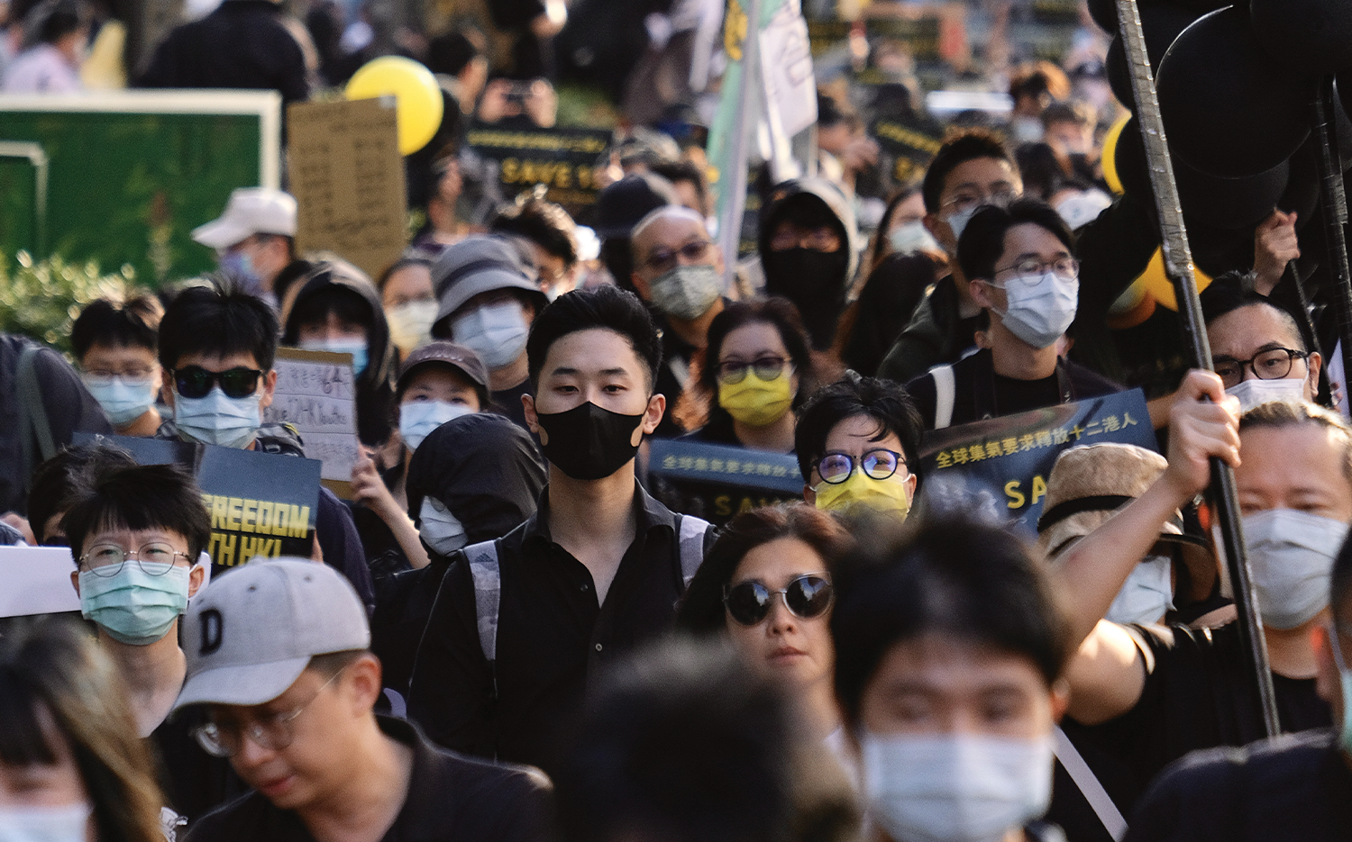 Demonstrators in Taipei gather to protest China's detention of Hong Kongers.