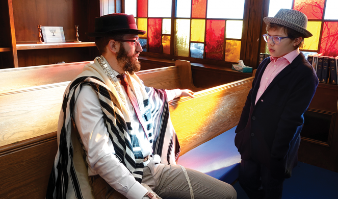 11½-year-old Daniel Delman talks with his Rabbi, Levi Welton, at the Lincoln Park Jewish Center in Yonkers.