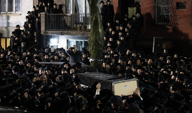 Orthodox Jewish men carry Moshe Deutsch's casket outside a Brooklyn synagogue following his funeral on Dec. 11, 2019. Deutsch was killed in a shooting inside a Jersey City kosher deli.