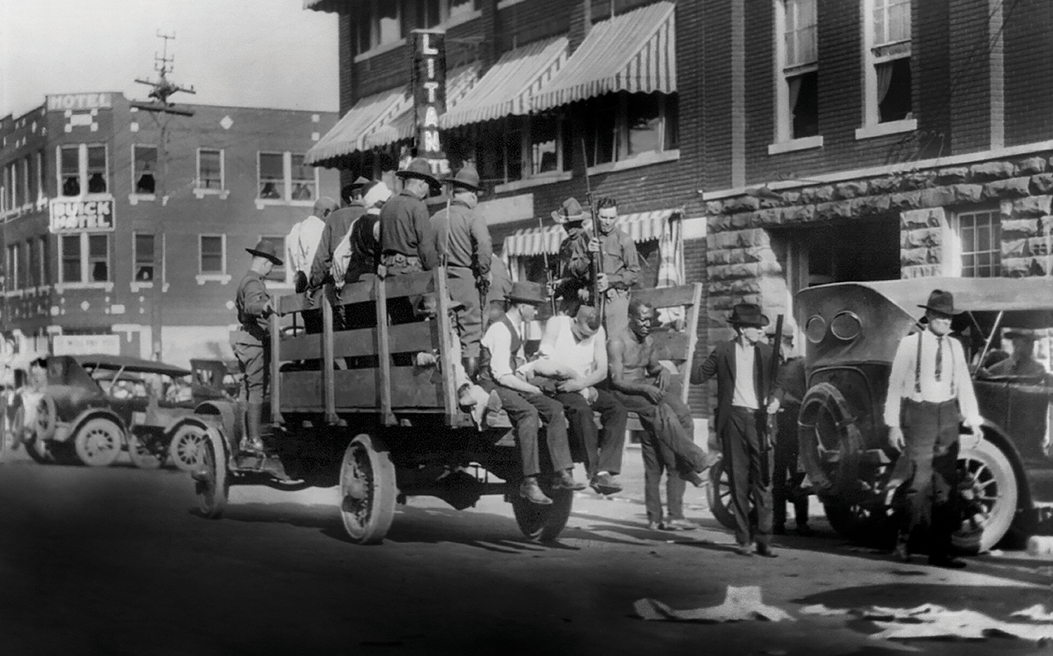 Soldiers guard black residents on a truck in Tulsa.
