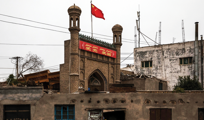 A Chinese flag flies over a mosque authorities closed in the old town of Kashgar, in Xinjiang province.