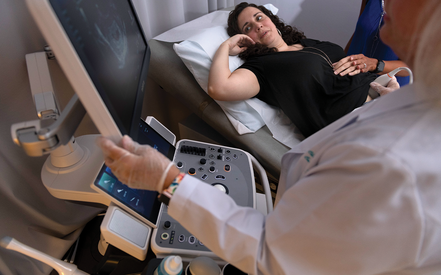Christiansen discusses what she sees in the ultrasound.