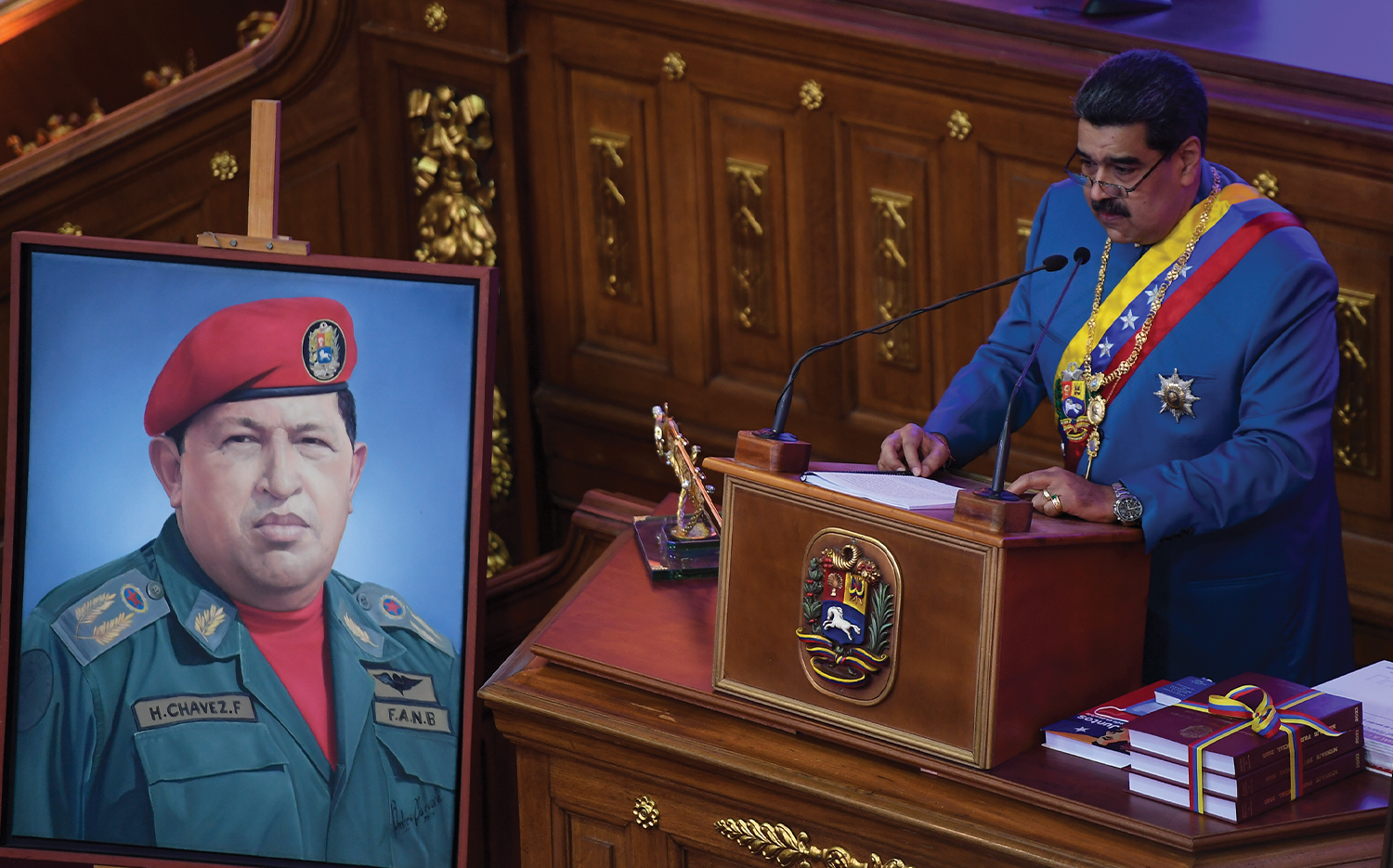 """""""THIS IS ABOUT POWER AND FORCE"""": Nicolás Maduro delivers his annual address to the nation last January near a portrait of Hugo Chávez."""