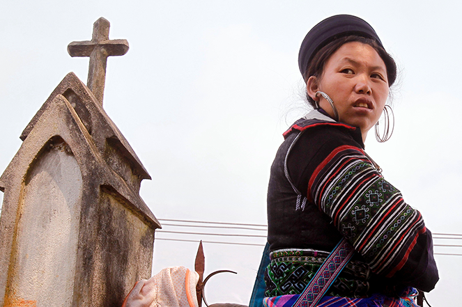 A Hmong woman on her way to church in Vietnam's northern Lao Cai province
