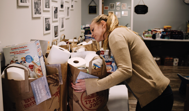 Scarlet Hope case manager Megan Musick prepares bags with food and supplies for clients.