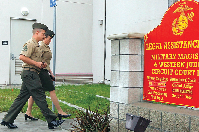 Staff Sgt. Frank Wuterich (left) arrives with his attorney for a court session at Camp Pendleton in 2012.